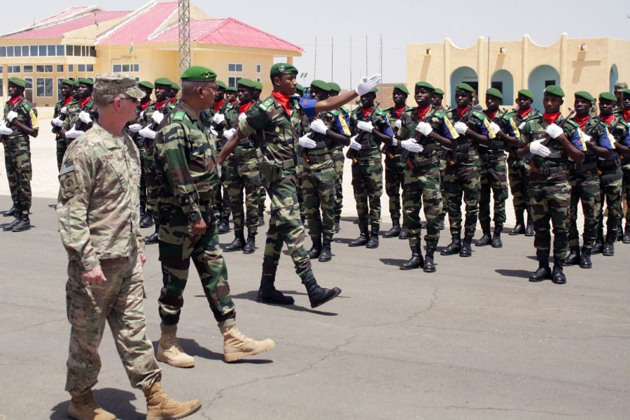 Maj. Gen. Marcus Hicks, leader of Special Operations Command Africa, left, reviews local troops in formation during a visit Thursday to Flintlock 2018 headquarters in Agadez, Niger.  Flintlock will be hosted by Burkina Faso with a key outstation in Mauritania. (FILE PHOTO)
