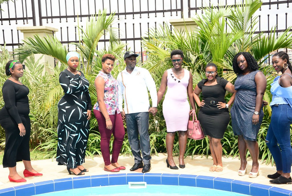 Minister Kiwanda poses with ladies during the launch of Miss Curvy beauty pageant. (FILE PHOTO)