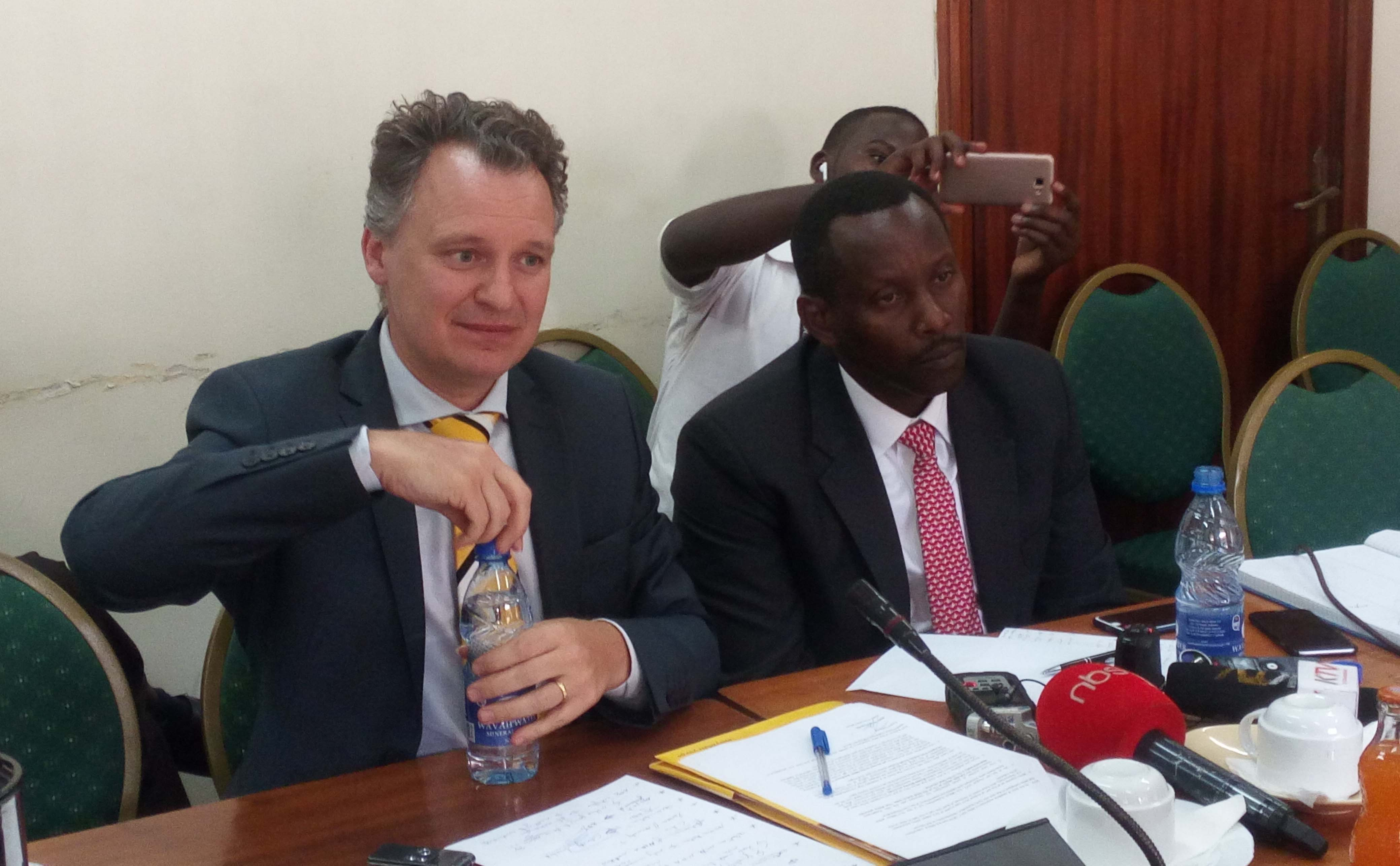 Former MTN Uganda boss Wim Vanhelleputt appears before MPs in the ICT committee on Monday August 22, 2018. in the company by the MTN chief legal officer Anthony Katamba (right). (FILE PHOTO)