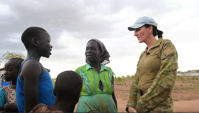 Major Bettina Stelzer, a U.N. peacekeeper from Australia, speaks with women and girls in Nakitun village, South Sudan