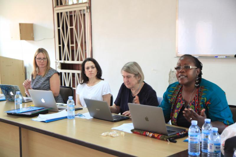 Dr Ahikire (R) and Prof. Chinkin (2nd R) in a meeting at the School of Women and Gender Studies. (PML PHOTO)