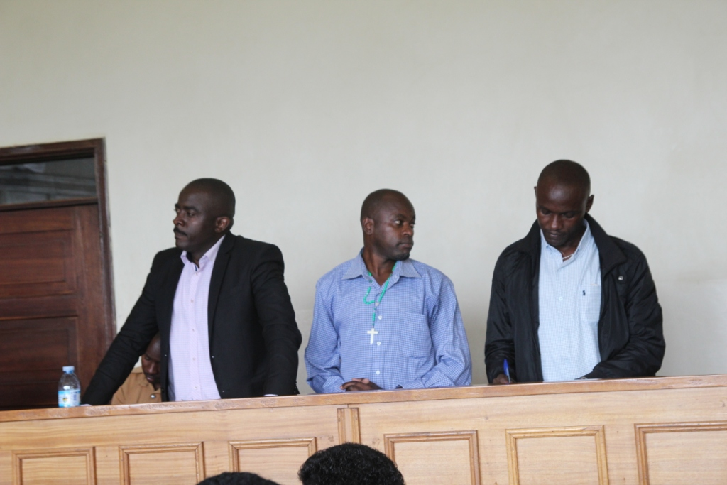 R-L Pte Denis Bataringaya, Emmanuel Mbaine and Don Kizito who were sentenced to 14 years