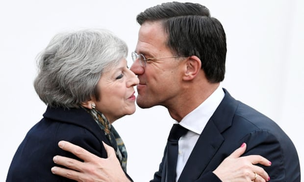 Theresa May being welcomed by Mark Rutte at a meeting in The Hague in December 2018. (REUTERS PHOTO)