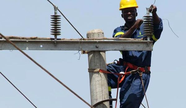 A technician for Rural Electrification Agency sets up a power line. (PHOTO/File)