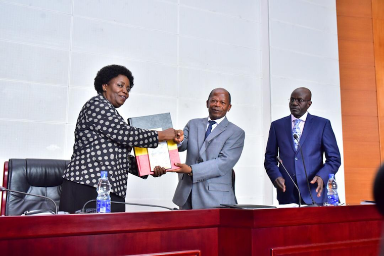 Prof Mary Okwakol, UNEB Chairperson formally hands over PLE 2018 results to the State Minister, Higher Education, John Muyingo last year (PHOTO/File)