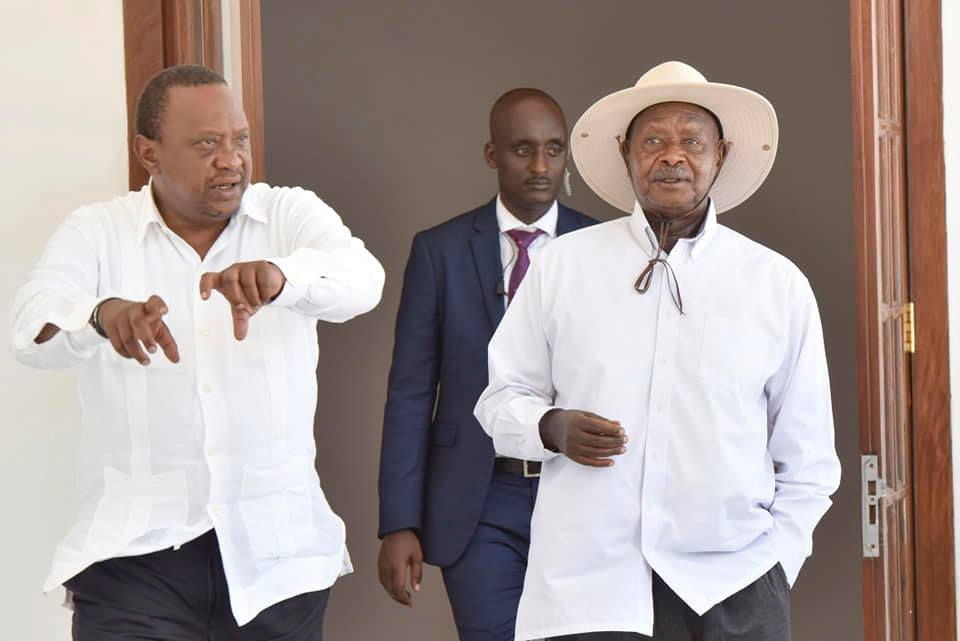 President Museveni and his Kenyan counterpart, Uhuru Kenyatta share a light at State House Mombasa Kenya (PPU PHOTO)