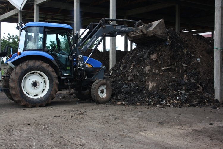 A tractor scoops through the rotten garbage at Mbale garbage recycling plant, the garbage remains at site as nobody is buyng it. David Mafabi[1]
