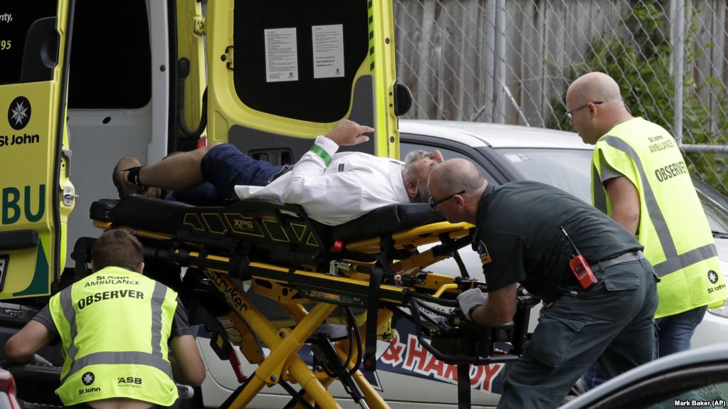 Ambulance staff take a man from outside a mosque in central Christchurch on March 15.