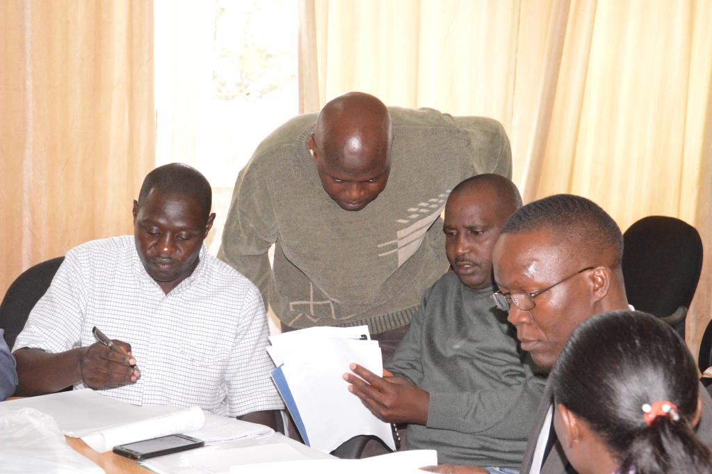 CFO Richard Kerere(standing) explaining the team on some documents.