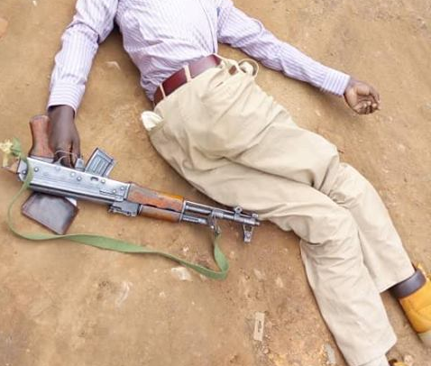 Yonathan Mbaine with his AK47 which he has been using to rob