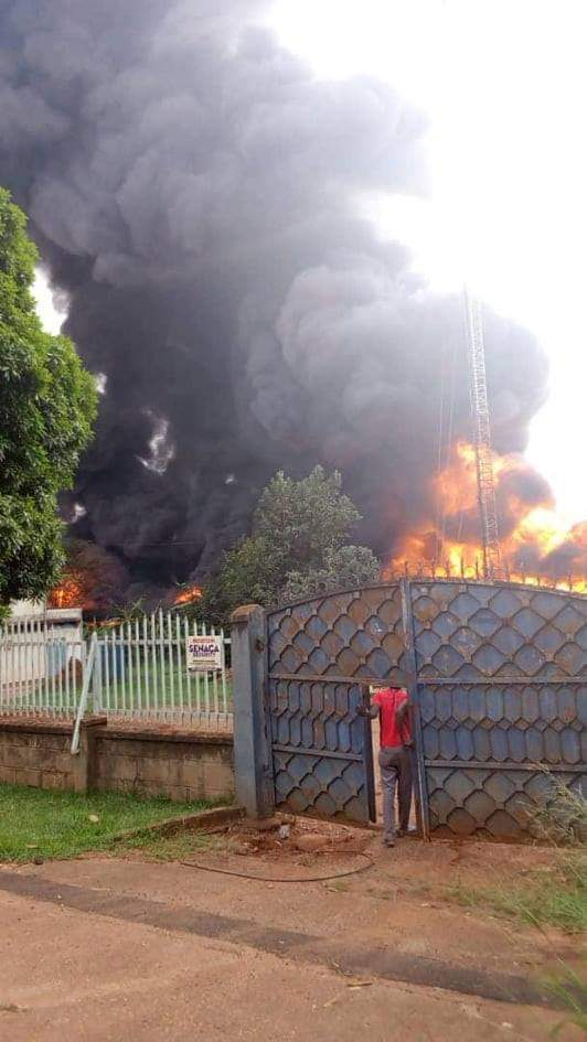 A fire razes Royal Foam factory in Kyambogo; darkening the skies with plumes of smoke (COURTESY PHOTO)