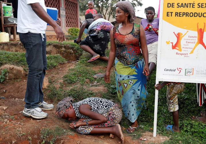 mother of a child, suspected of dying from Ebola, cries outside a hospital during the funeral in Beni, North Kivu Province of Democratic Republic of Congo, December