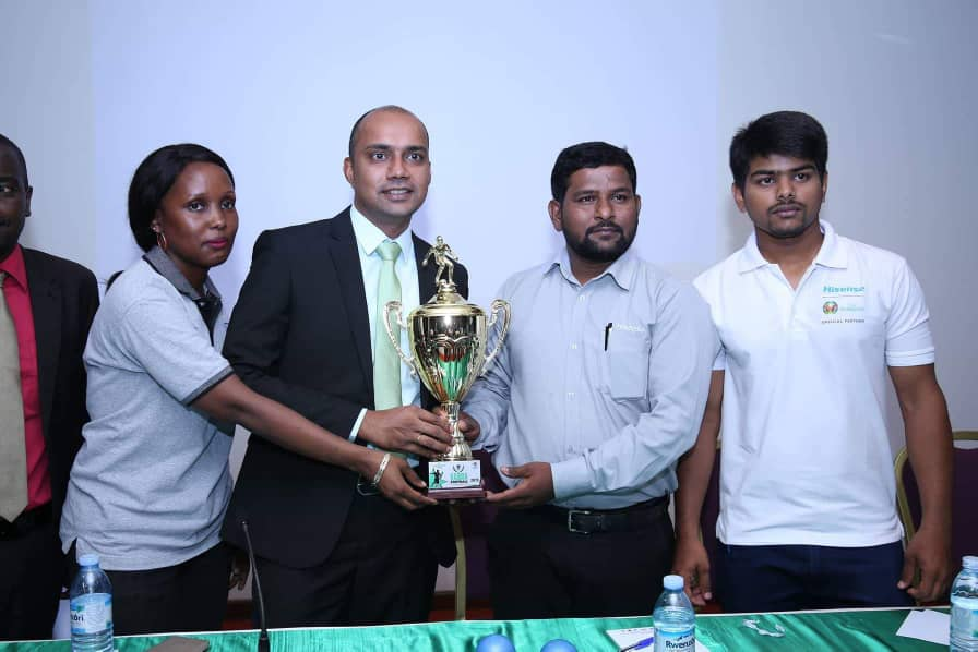 Ms.Esther Musoke  Marketing Manager Fufa (left) , Rakesh Hurrycurn  General manager (Middle)  Kabira and officials from Hisense the sponsors of the Tournament( Photo Mutalyebwa ABRAHAM)
