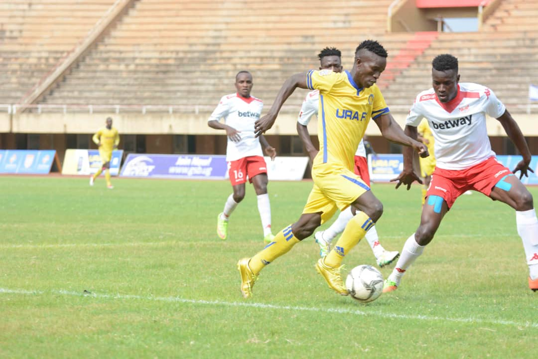 URA (yellow) now move into third on the log (Photo by Shaban Lubega)