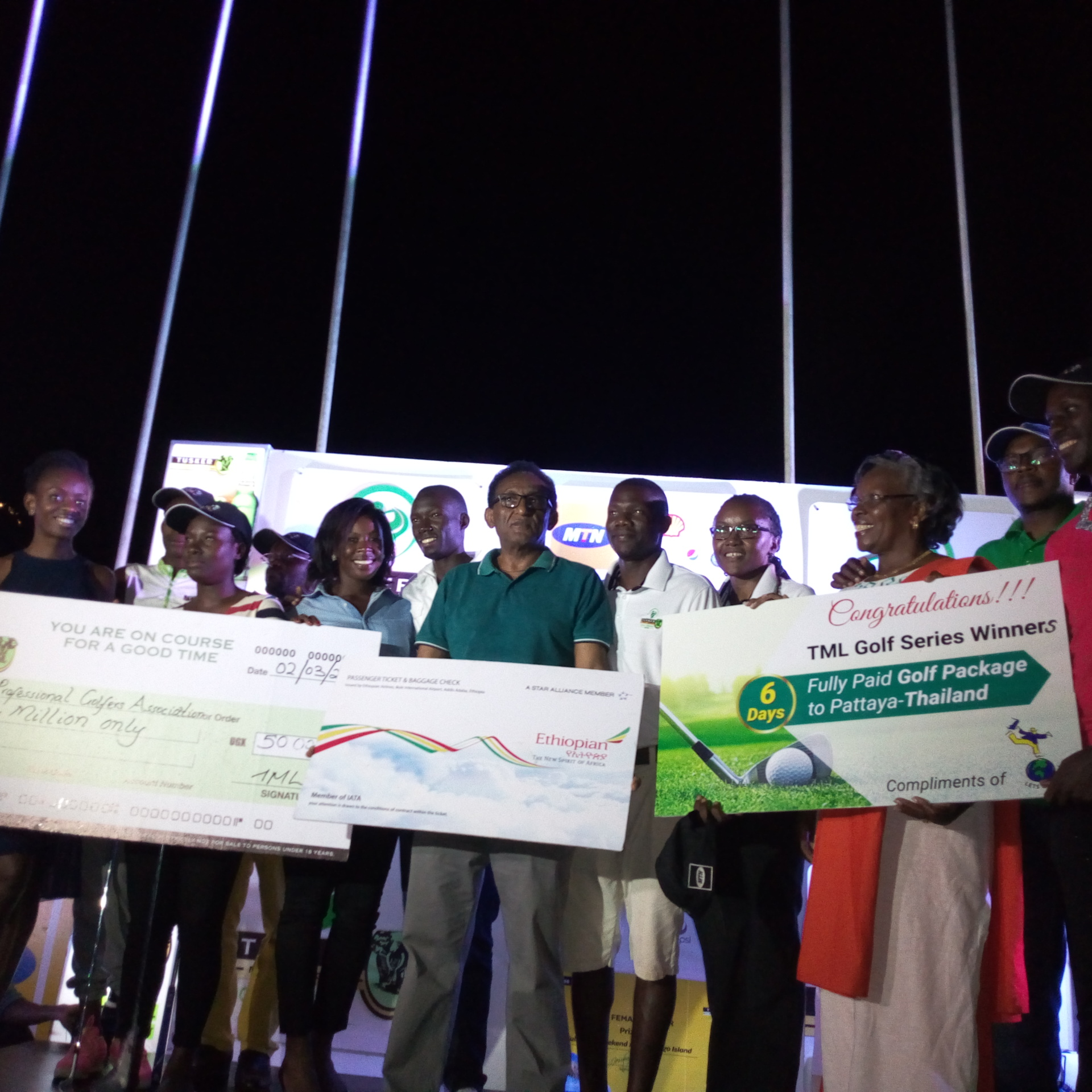 Some of the winners pose with officials (Photo by Abraham Mutalyebwa)