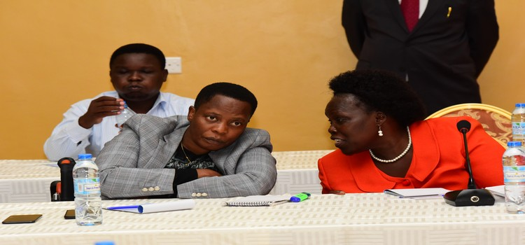 LoP Aol Ocan  interacting with Betty Nambooze during the Shadow Cabinet meeting held at Imperial Golf Hotel in Entebbe. (PML PHOTO)
