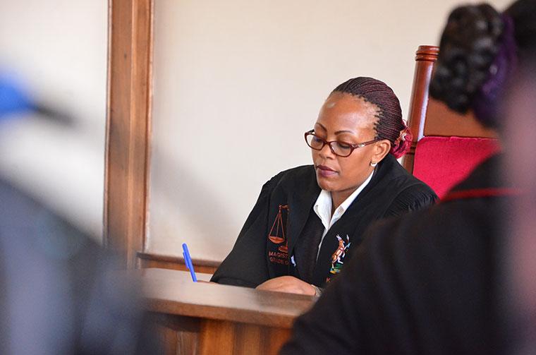 Buganda Road Court Magistrate Kamasanyu Gladys takes notes in a hearing. (FILE PHOTO)