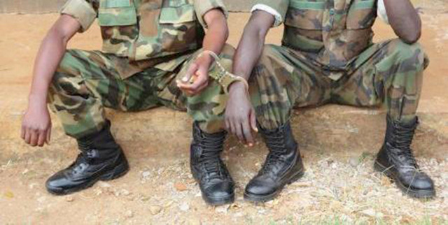 Two UPDF soldiers nabbed in a foiled robbery and paraded before the press. Security agencies have been left in shock as the number of crimes have had UPDF personnel involved. (PHOTO/File)