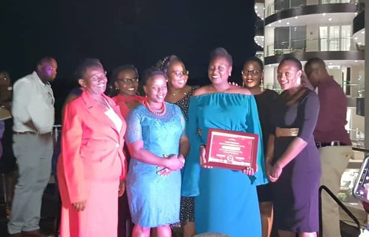 Some of the galant women share a light moment with Kwezi Byaruhanga of Kembabazi Catering (COURTESY PHOTO)