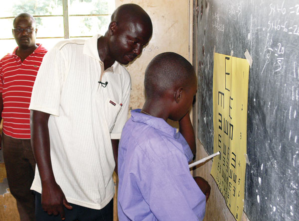 A teacher engages a special needs pupil in an exercise in class. (MOES PHOTO)