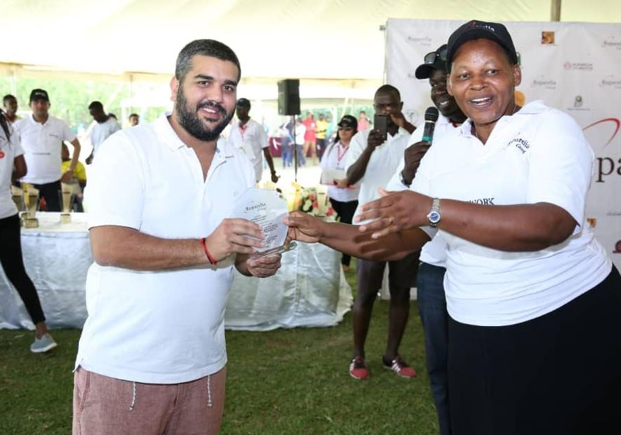 Naiya Ruparelia receiving an award from the headmistress of Kampala parents school( Photo Abraham Mutalyebwa