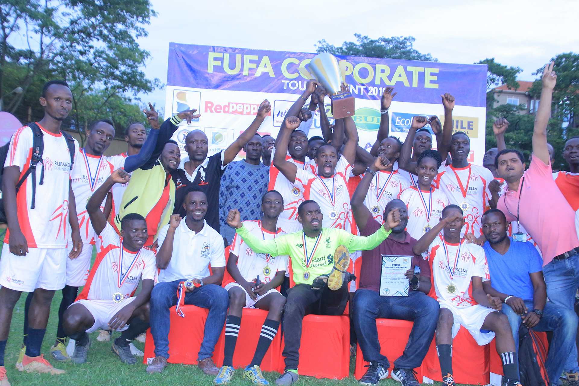 KISU players and staff celebrate winning the 5th FUFA Corporate tournament. (FUFA Photos)