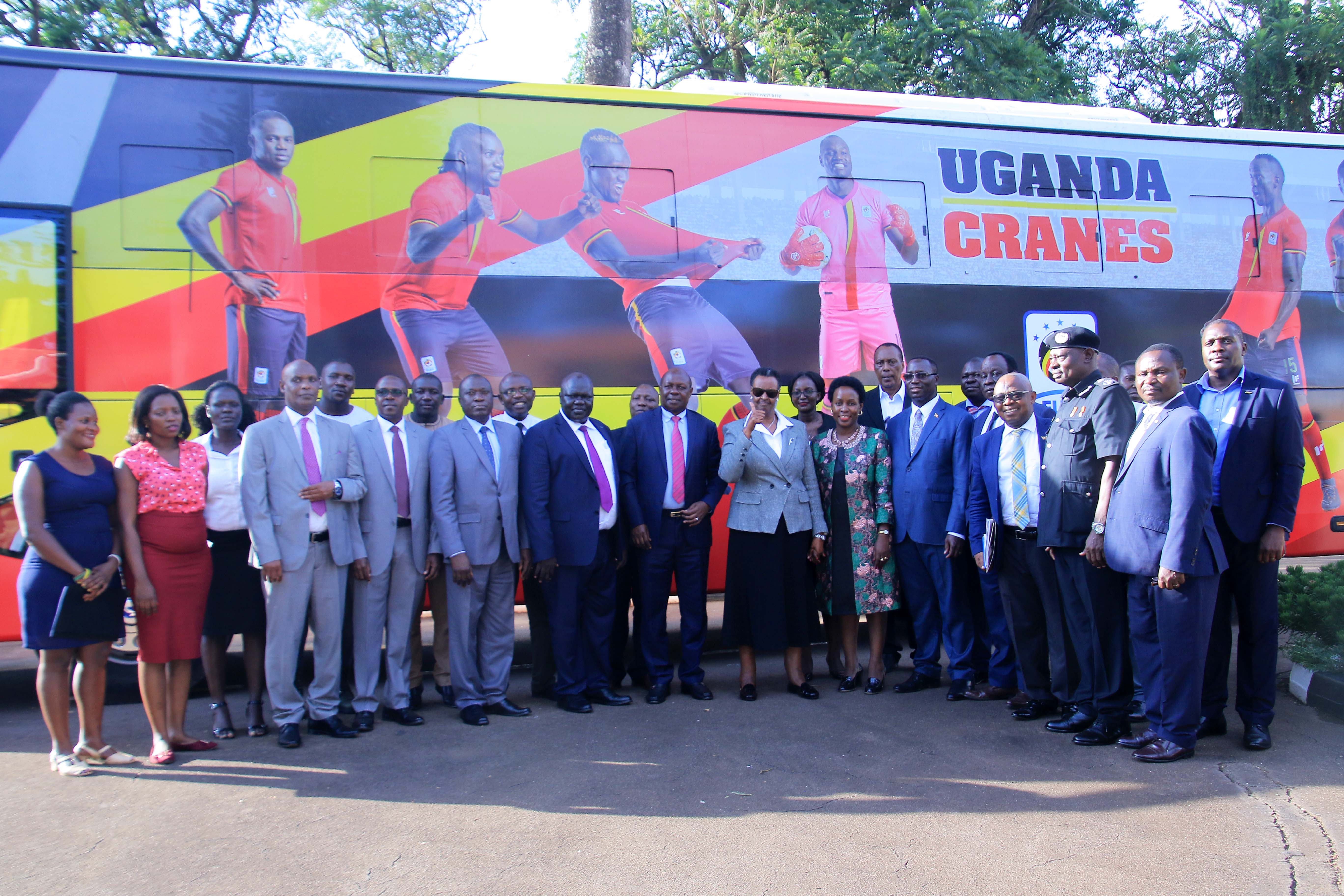 Those in attendance at the hand over, pose for a picture in front of the Cranes bus (FUFA Photos)