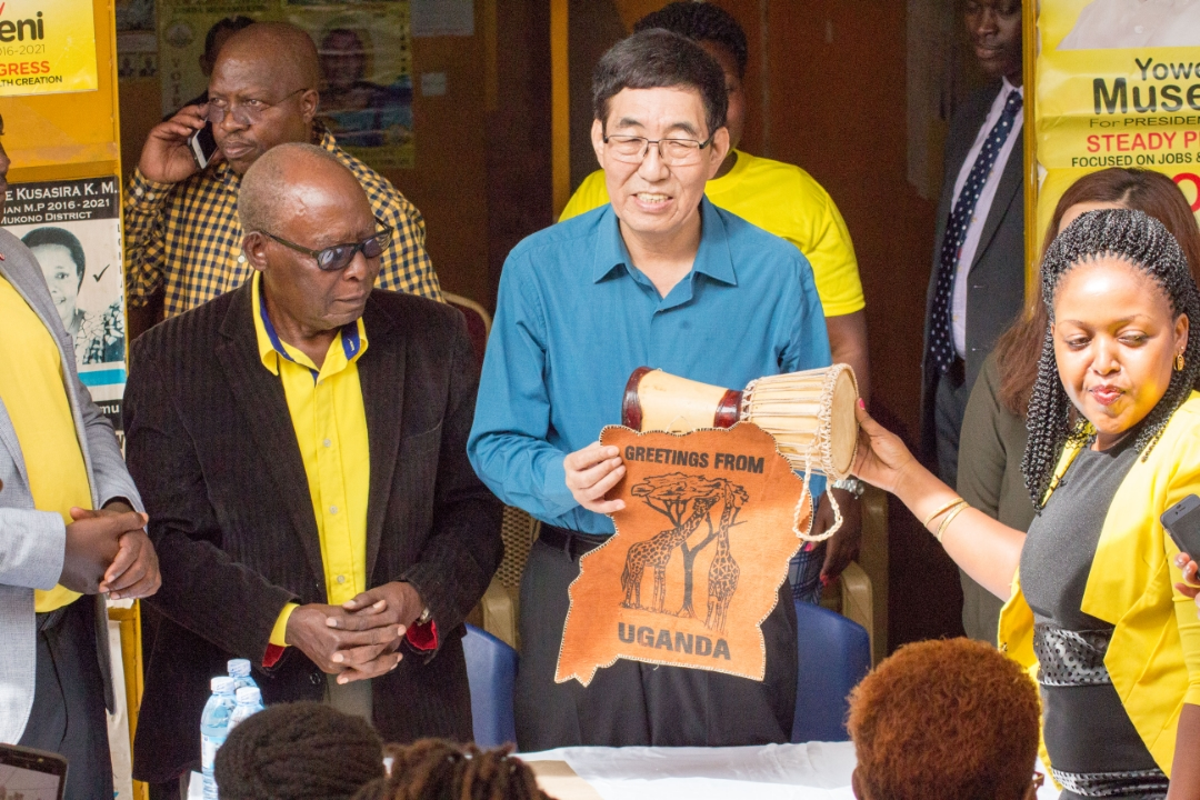NRM officials hand gifts to