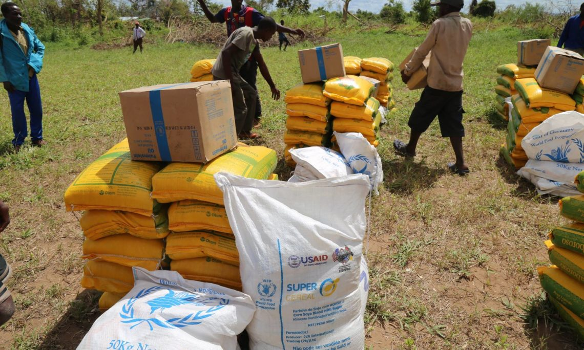 Mozambicans in the areas impacted by Cyclone Idai help distribute food assistance delivered by the U.S. Government.