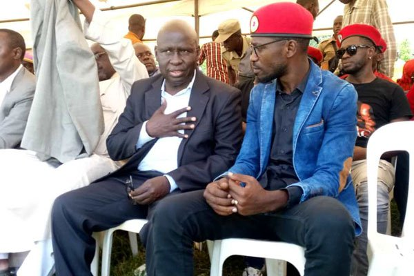 Bobi Wine and Former Bukhooli Central MP Wafula Oguttu in Bugeso Village, Lwemba Sub-county in Bugiri District where the burial ceremony of former Bugiri District chairperson Siraji Lyavala is underway. (PHOTO/COURTESY)