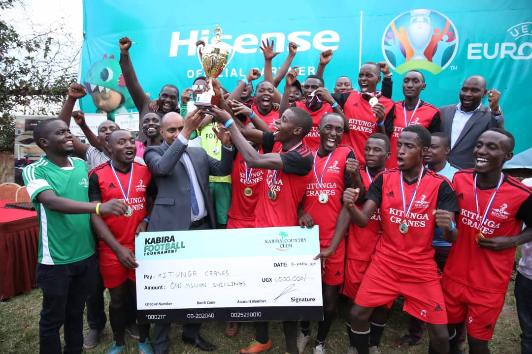 Kitunga Alumni the Winners  lifting their Trophy with Kabira Country Club General Manager Rakesh Hurrychurn  at Kabira on Sunday. (Photo Abraham Mutalyebwa)