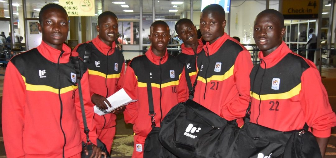Some of the Cubs players pose for a photo at Entebbe Airport on Sunday (FUFA Photos)