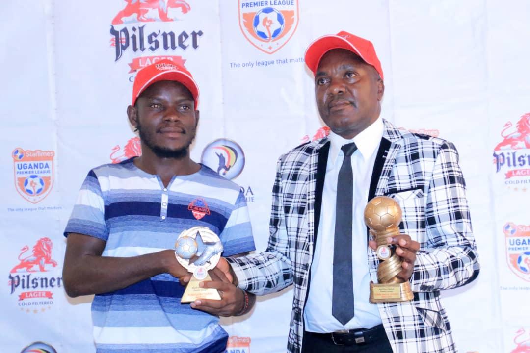 Bagoole (left) and Simbwa (right) pose with their accolades at Kati Kati Restaurant. (Agency Photos)