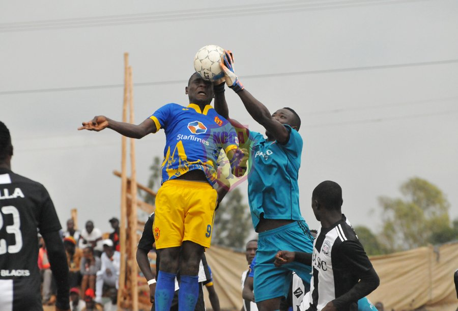 Patrick Kaddu (left) tries to head the ball under pressure from Paidha's goalkeeper (KCCA FC photos)