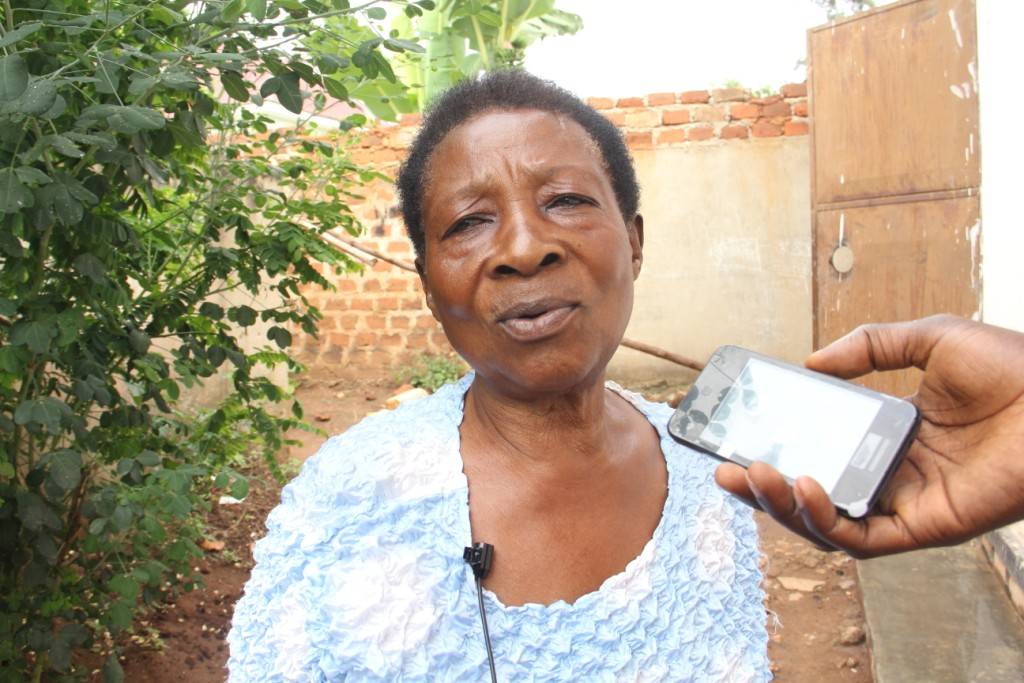 Grandmother Jane Nakku talking to the media during an interview about what had happened