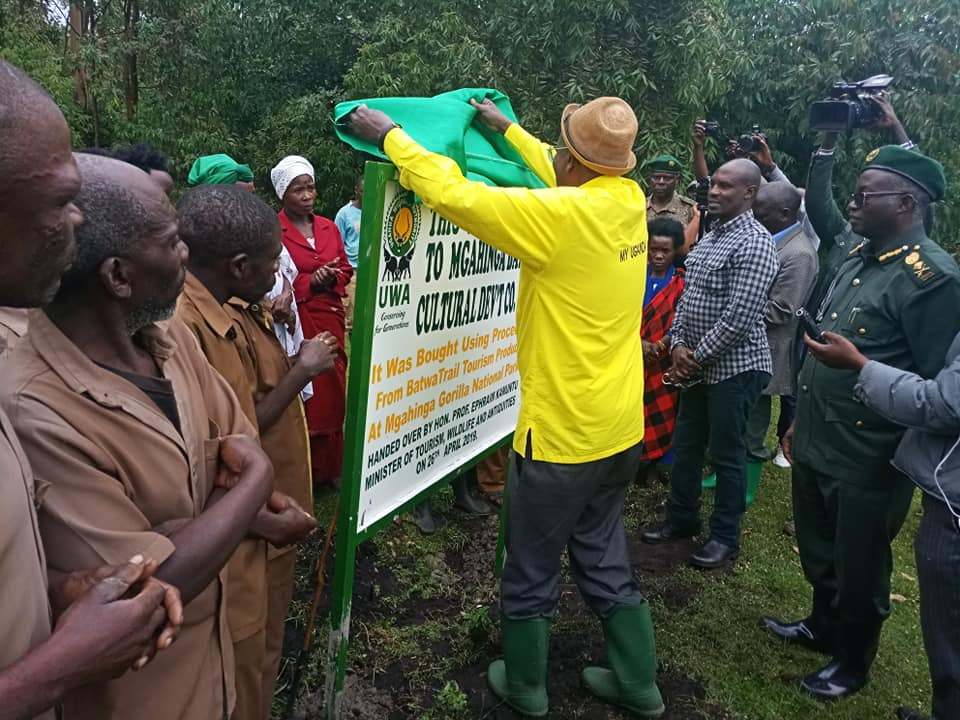 The Minister of Tourism Prof. Ephraim Kamuntu hands over 2 pieces of land measuring 3.5 and 4 acres in Nyagacence and Musana respectively to the Batwa Community neighboring Mgahinga Gorilla National Park. (PHOTO/PML)