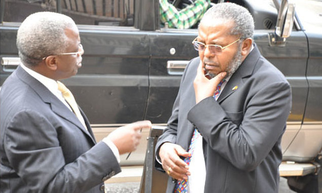 Legal team of former Prime Minister Amama (L) Mbabazi and city tycoon Humphrey Nzeyi have resurrected an old court filed against Governon Emmanuel Mutebile led Central Bank citing that their Bank, National Chamber of Commerce was closed (FILE PHOTO)