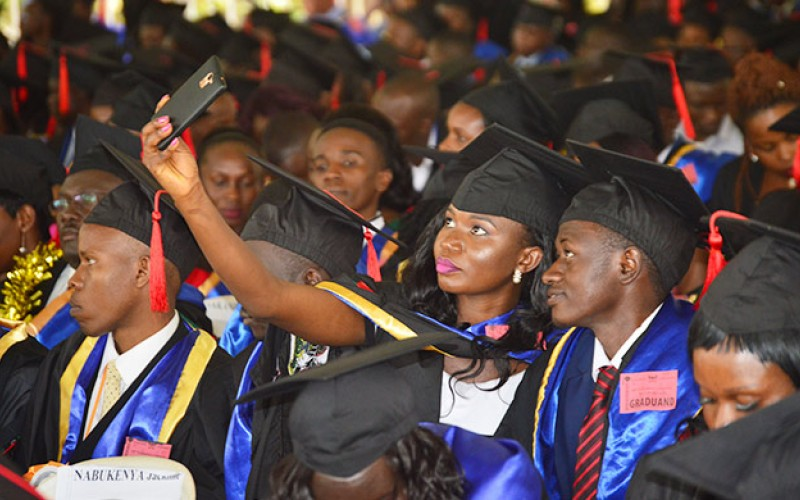 A graduand takes a selfie during the 68th Graduation Ceremony in January 2018. (PHOTO/FILE)