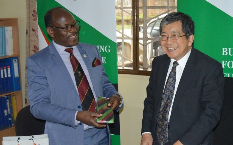 The Vice Chancellor, Prof. Barnabas Nawangwe (Left) presents the Mak necktie to Japanese Ambassador H.E. Kazuaki Kameda (Right) during his visit to the AICAD Uganda Country Office on 17th April 2019, Makerere University, Kampala Uganda  The
