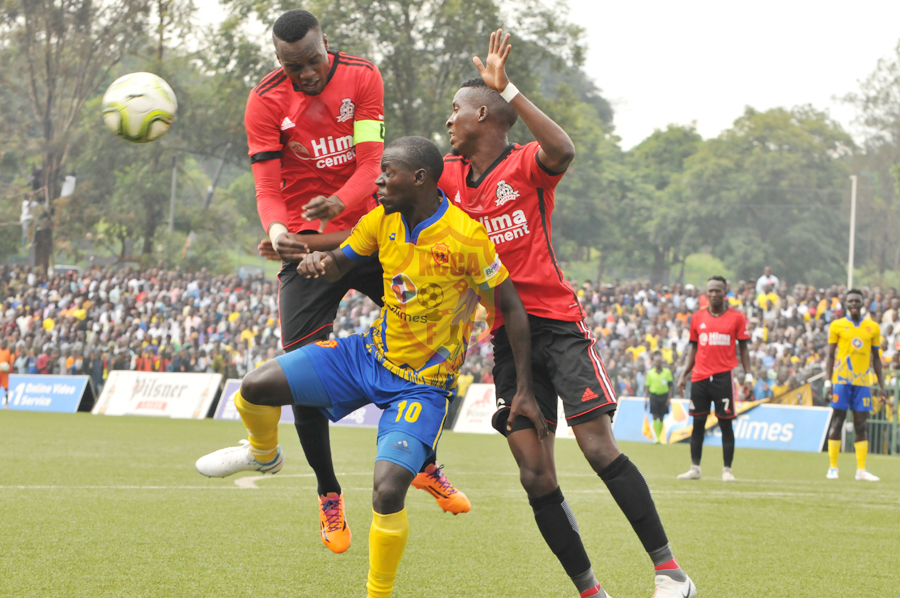 KCCA's Muzamir Mutyaba tries to control the ball under pressure from Vipers' duo of Tadeo Lwanga (left) and Moses Waiswa (right). (KCCA FC Photo)
