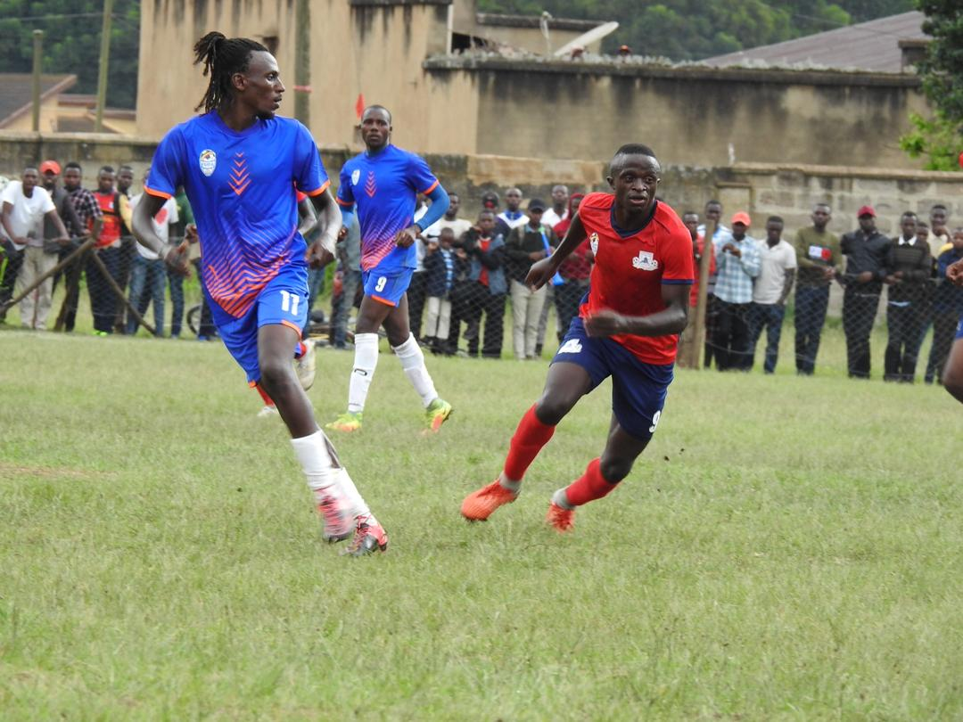 Kigezi forward Micheal  Birungi (left) and Bukedi's Timothy Owori (right) in action on Sunday.