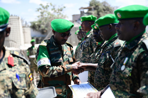 Lt. Gen. Tigabu Yilma Wondimhunegn, the AMISOM Force Commander pins a medal on a Ugandan soldier during a medal award ceremony for Ugandan soldiers serving under the African Union Mission in Somalia (AMISOM), who have completed their tour of duty in Somalia. The event took place in Mogadishu on 15 April 2019. AMISOM Photo / Ilyas Ahmed