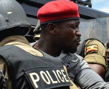 Kyadondo East MP Robert Kyagulanyi alias Bobi Wine flexes with Police officers. The People Power pressure group leader has  (FILE PHOTO)