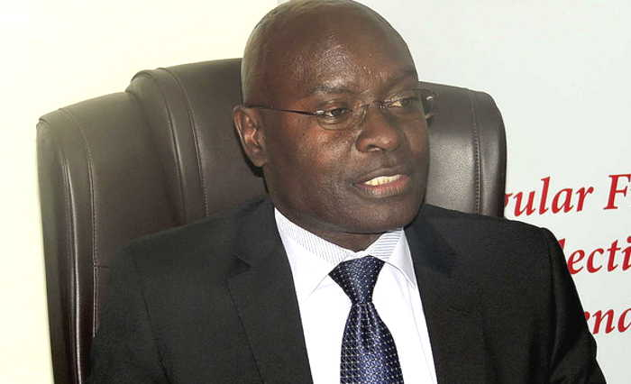 Chairperson of the Electoral Commission, Justice Simon Byabakama has revealed that government is in the final stage of drafting a bill to bar independent candidates (FILE PHOTO)