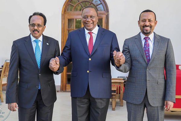 Presidents Mohamed Abdullahi Farmajo of Somalia (left), Kenya's Uhuru Kenyatta and Ethiopian Prime Minister Abiy Ahmed pose for a photo after a meeting on the maritime border row at State House Nairobi recently. (PHOTO/COURTESY)