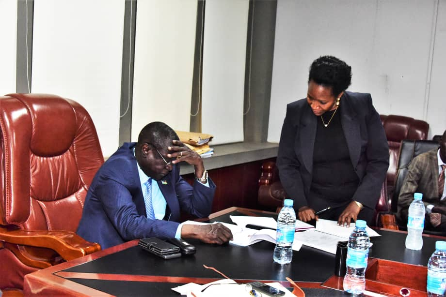 Ann Maria Nankabirwa presenting a list of traders to South Sudan's Minister of Finance and Planning, Salvatore Garang. (PHOTO/File)