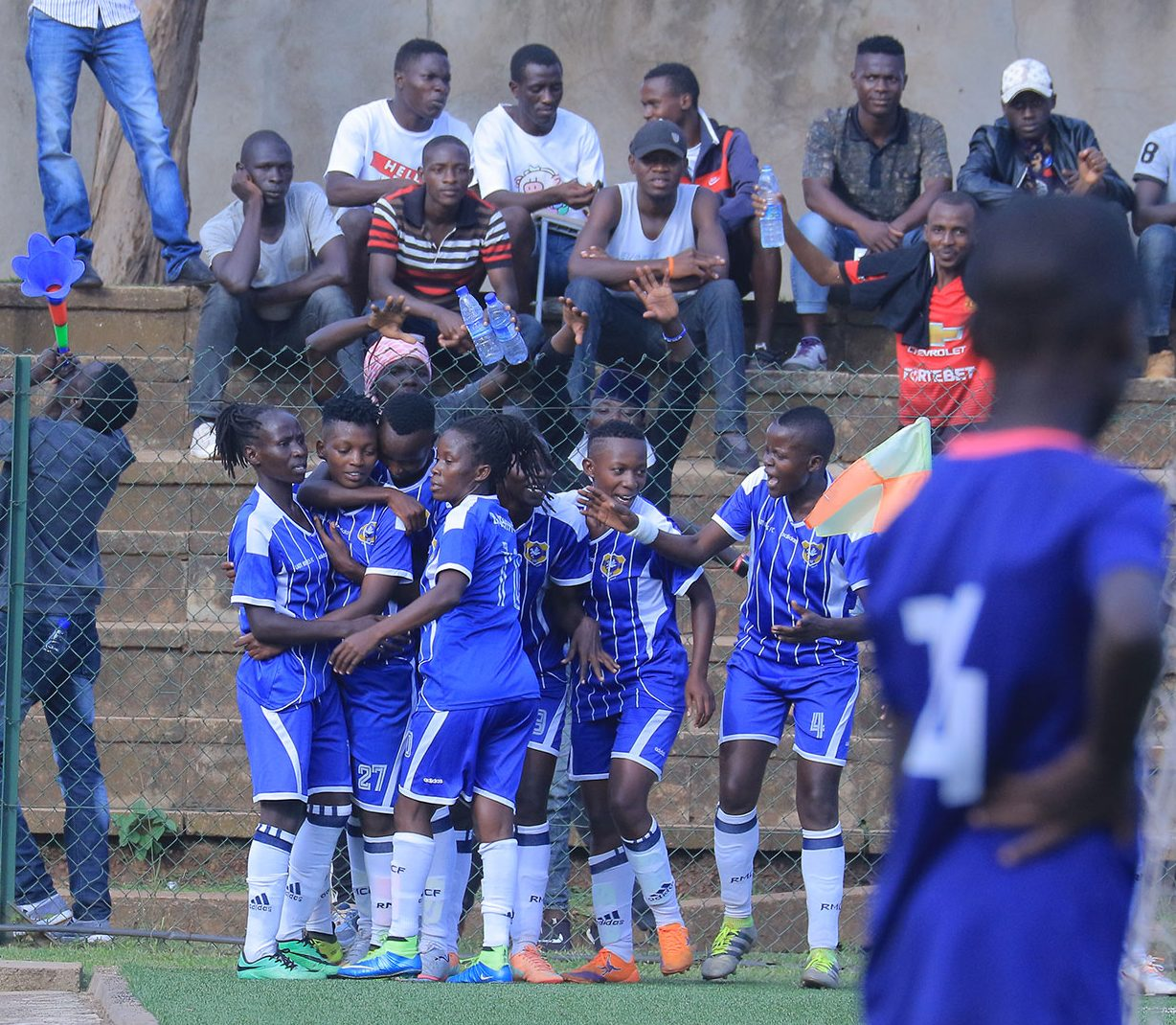 Nabbosa (27) is congratulated by her teammates after scoring the all-important goal in the victory over Kampala Queens on Thursday. (PHOTOS/FUFA)