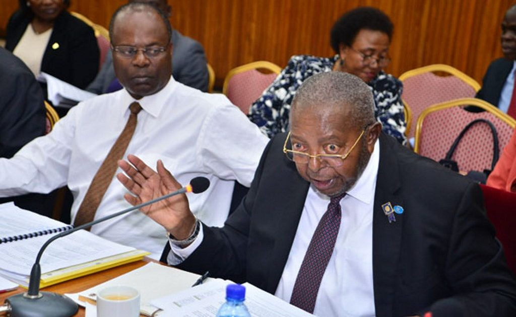 Bank of Uganda Governor Emmanuel Tumusiime Mutebile and his former deputy Louis Kasekende appear before a parliamentary committee recently.  (PHOTO/File)