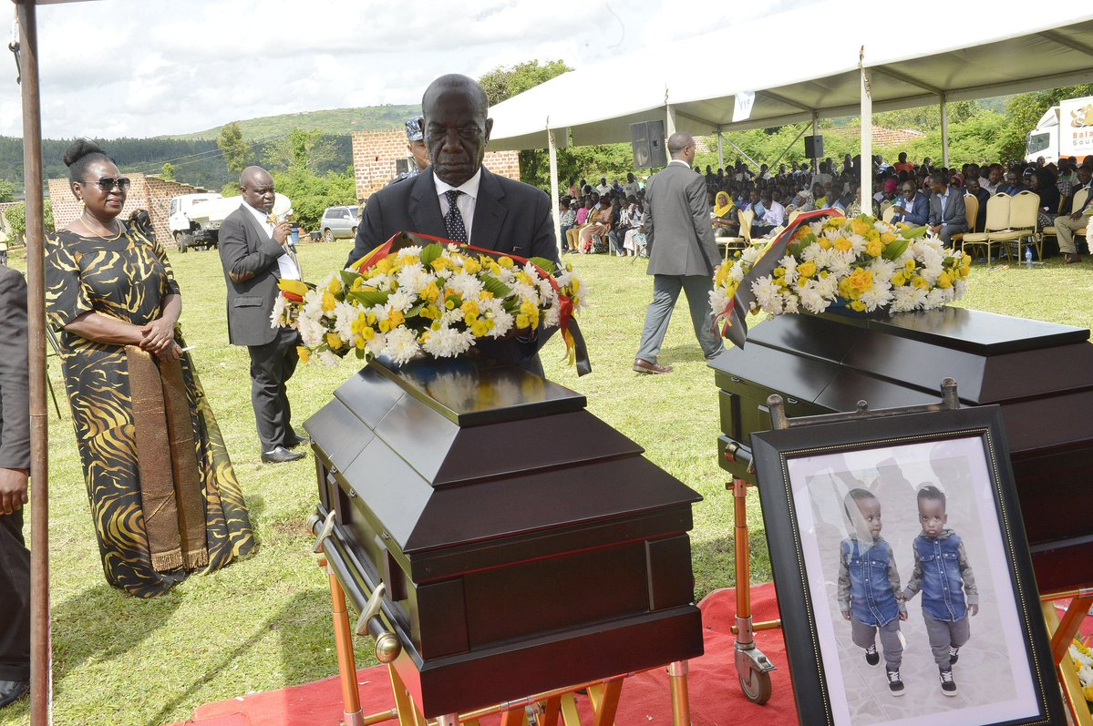 Represented President Museveni at the burial of Hon. Ronald Kibuule's twin, VP Edward Ssekandi lays a wrealth. (PHOTO/Courtesy)
