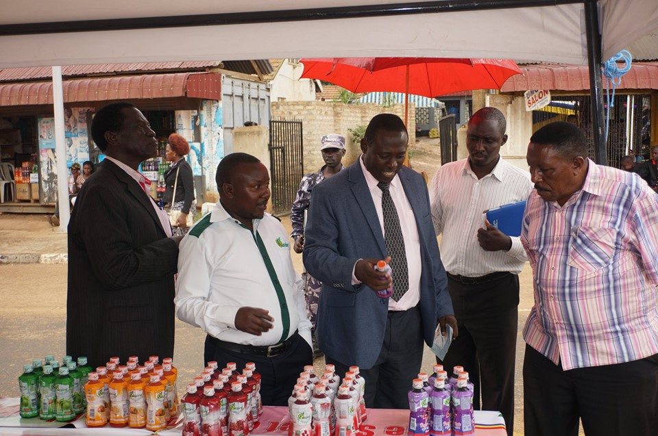 Dr. Mutambi with other manufacturerers inspecting Kazire health products stall